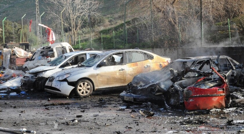 The remains of cars are pictured Monday after a car bomb went off at the Cilvegozu border crossing between Turkey and Syria.