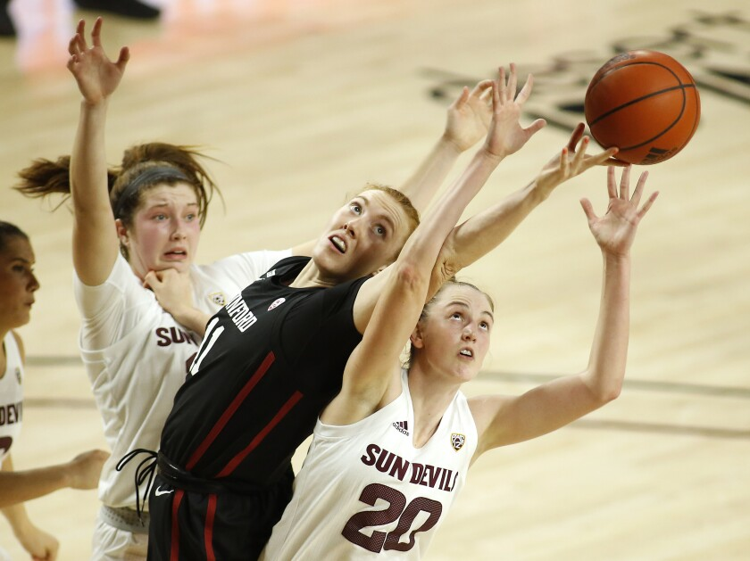 Stanford's Ashten Prechtel (11) battles for a rebound with Arizona State's Katelyn Levings (20) during the first half of an NCAA college basketball game Sunday, Jan 3, 2021, in Tempe, Ariz. (AP Photo/Darryl Webb)