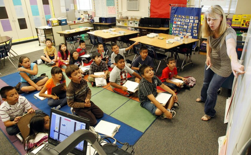 Students study math with third-grade teacher Kelly Nytes at Central Elementary School in San Diego where educators say smaller classes have made a difference. Gov. Jerry Brown proposes giving school districts more flexibility over spending on such programs.