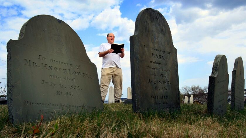 Walter Skold reads a Henry Wadsworth Longfellow poem while standing in front of the tombstones in Eastern Cemetery in Portland, Maine.