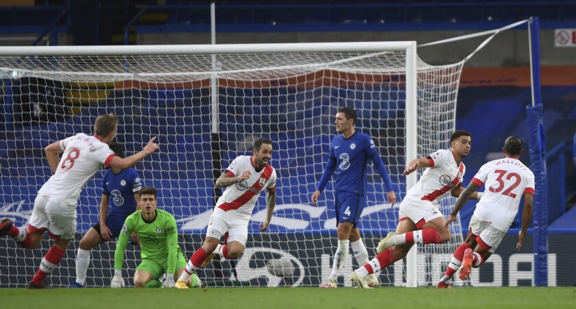 Southampton's Che Adams, second right, celebrates after scoring his side's second goal during the English Premier League soccer match between Southampton and Chelsea at the Stamford Bridge in London, England, Saturday, Oct. 17, 2020.(Mike Hewitt/Pool via AP)