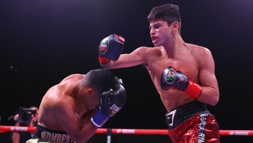 Ryan Garcia, right, throws a punch during his victory over Jose Lopez on March 30.
