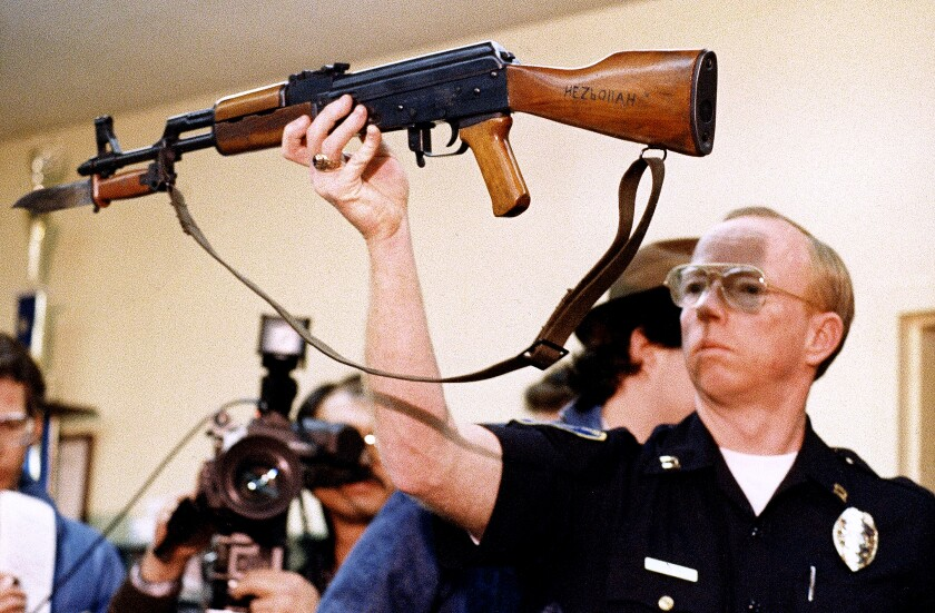 Stockton Police Captain J.T. Marnoch holds up a Chinese-made AK-47 assault rifle in 1989