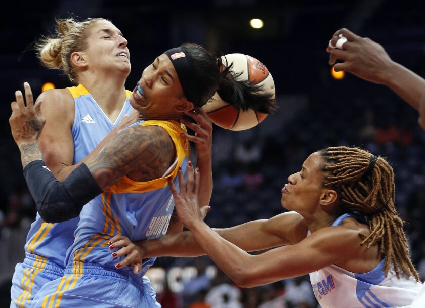 FILE - In this Aug. 26, 2014 file photo, Chicago Sky's Elena Delle Donne, left, and Tamera Young battle Atlanta Dream's Jasmine Thomas, right, for a rebound in the first half of Game 3 of the WNBA basketball Eastern Conference semifinals, in Atlanta. Chicago won 81-80. The Atlanta Dream hope a devastating loss in last year's WNBA playoffs will provide some valuable lessons for the new season. After claiming the No. 1 seed in the Eastern Conference, the Dream were upset in the opening round by the Chicago Sky, squandering a 17-point lead at home in the fourth quarter of the deciding game. (AP Photo/John Bazemore, File)