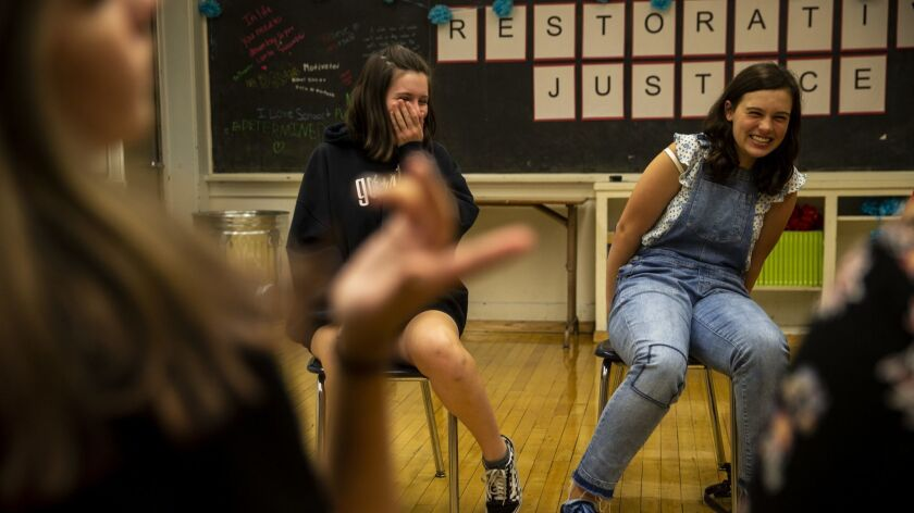 LOS ANGELES, CALIF. - JULY 11: Leila Corran, 14, and Emily Cliborn, 14 share a laugh while discussin