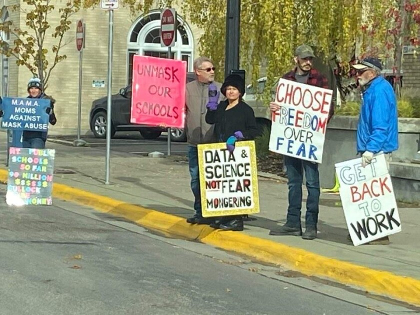 Dr. Annie Bukacek, center, in black, joins demonstrators in Kalispell protesting mask requirements in schools.