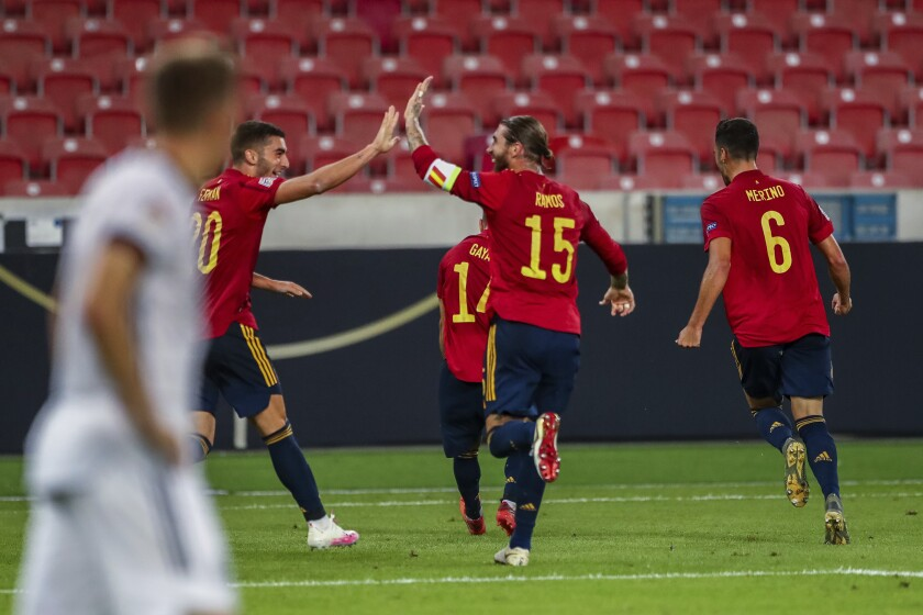 Spain players celebrate after scoring during the UEFA Nations League soccer match against Germany at the Mercedes-Benz Arena stadium in Stuttgart, Germany, Thursday, Sept. 3, 2020. (AP Photo/Matthias Schrader)