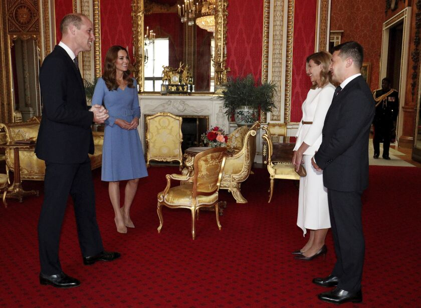 Britain's Prince William and Kate, Duchess of Cambridge meet the Ukraine President Volodymyr Zelenskiy, right, and his wife, Olena, during an audience at Buckingham Palace, London, Wednesday Oct. 7, 2020. The President is on a two day official visit to Britain. (Jonathan Brady/Pool via AP)
