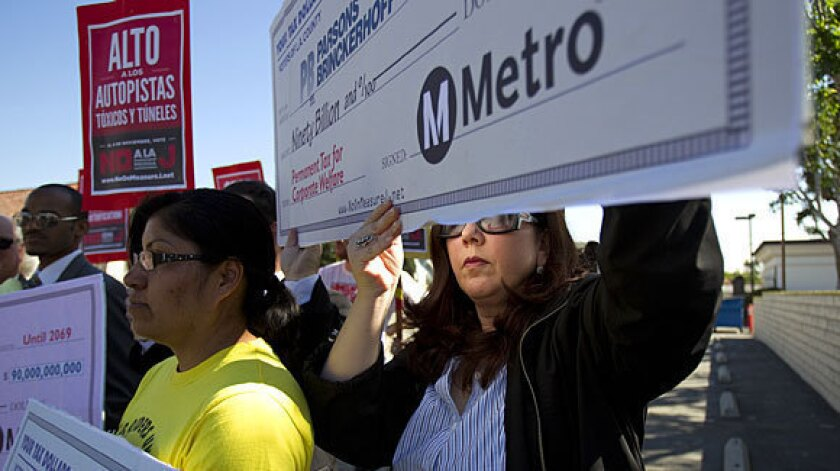 Lisa Korbatov, right, of Beverly Hills joins Rosa Miranda of the Bus Riders Union holding blank checks highlighting Measure J's corporate sponsors and beneficiaries during an October rally.