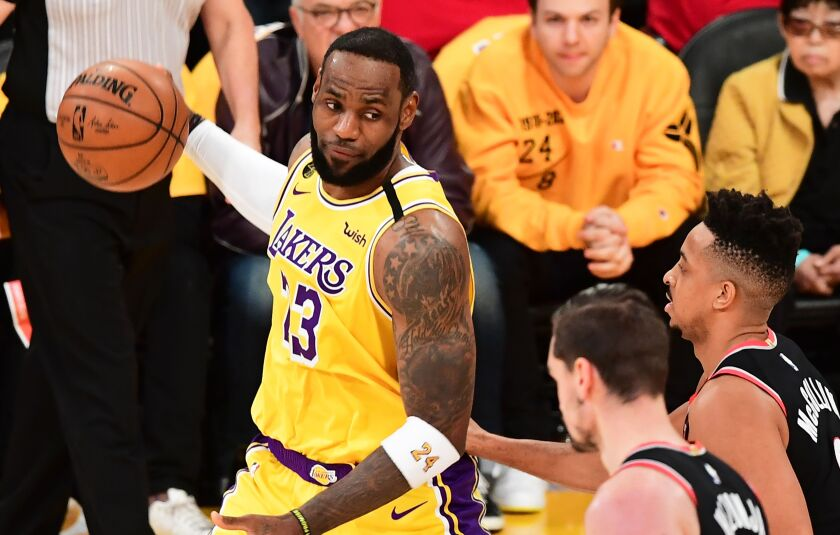 Lakers star LeBron James looks to pass under pressure.