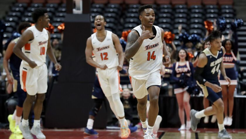 Cal State Fullerton guard Khalil Ahmad (14) celebrates a basket during the second half of an NCAA co