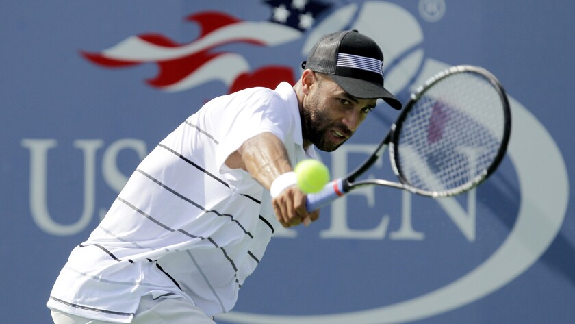 James Blake hits a backhand