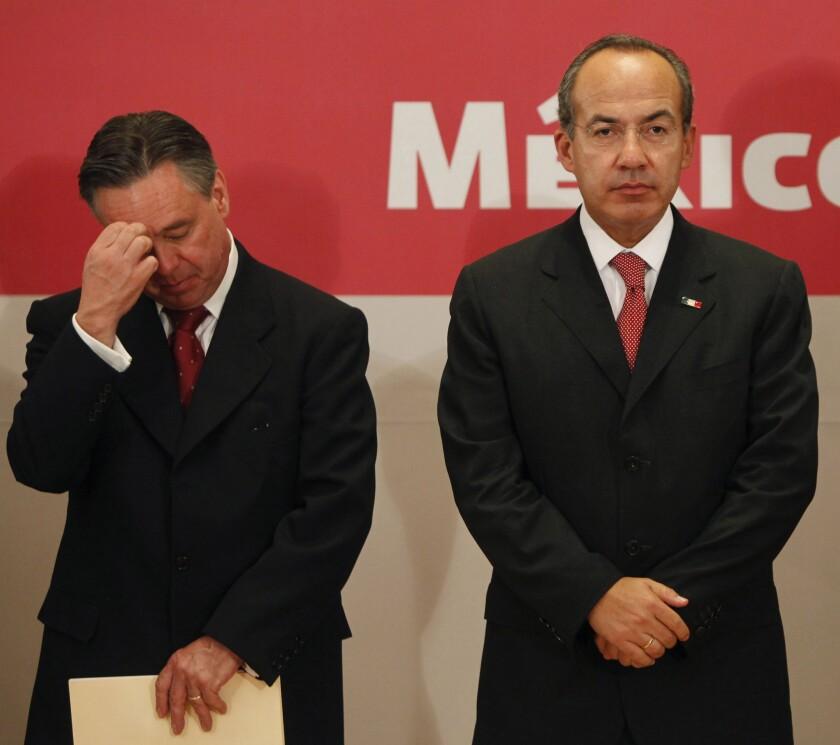 Then-Mexican Atty. Gen. Eduardo Medina Mora, left, and then-President Felipe Calderon at a Sept. 7, 2009, news conference in Mexico City where Calderon announced Medina Mora's resignation.