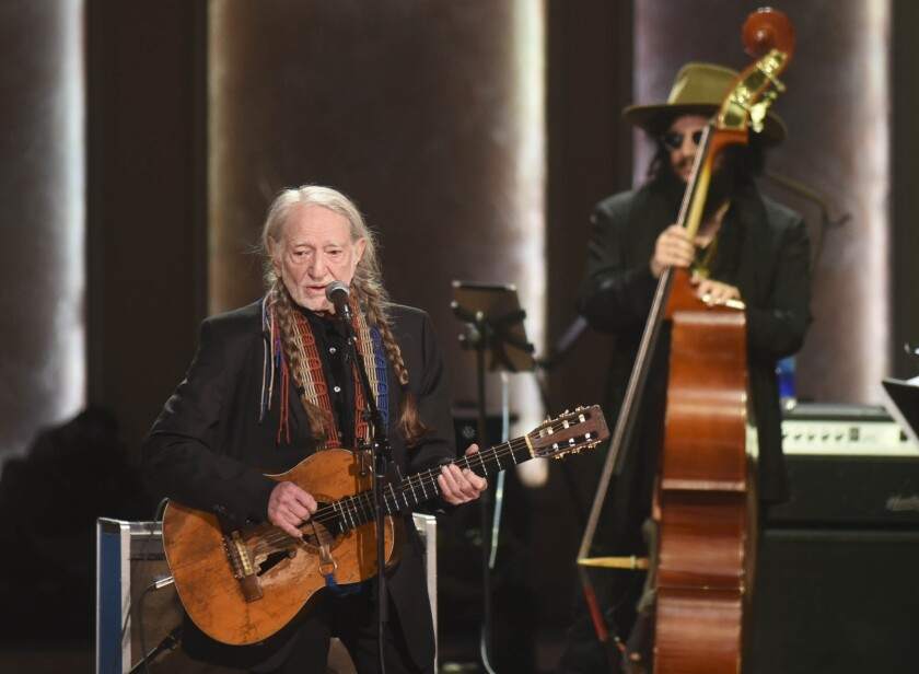 Willie Nelson, shown above with bassist Don Was, is set to kick off his 2020 winter tour in San Diego on Friday.