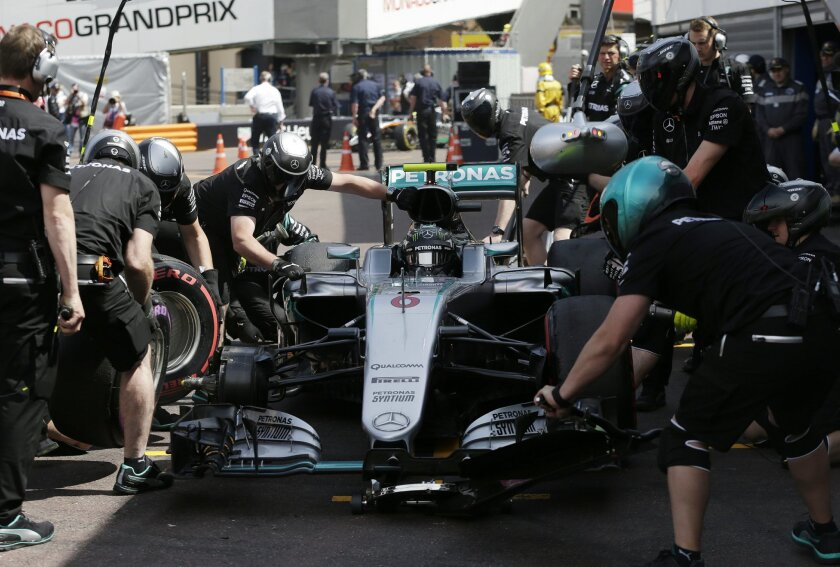 Mercedes driver Nico Rosberg of Germany has his tires changed during the second free practice at the Monaco racetrack in Monaco, Thursday, May 26, 2016. The Formula one race will be held on Sunday. (AP Photo/Petr David Josek)