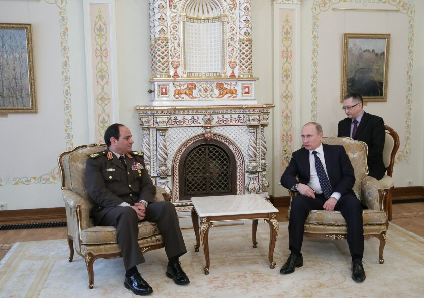 Russian President Vladimir Putin, right, meets with visiting Egyptian Field Marshal Abdel Fattah Sisi at a government palace near Moscow.