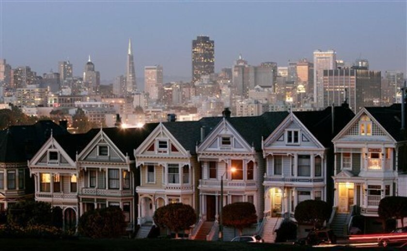 In this Monday, May 12, 2008, photo, a row of historical Victorian homes, underscore the San Francisco skyline in a view from Alamo Square,Calif. Apartment rents in San Francisco have soared beyond
