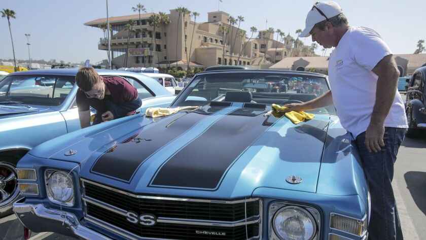 Rick Bach, right, and his son Gabriel Bach polish their 1971 Chevrolet Chevelle Friday during the Go