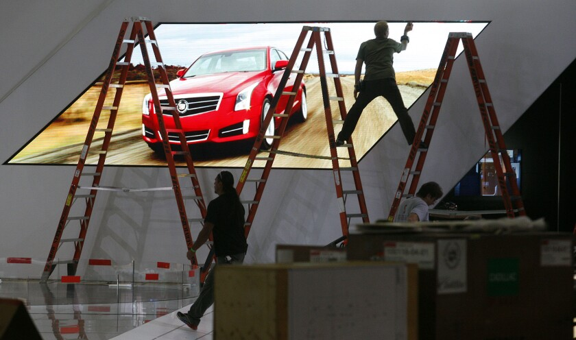 The Cadillac booth under construction at the 2012 L.A. Auto Show. GM's luxury arm has confirmed the high-performance ATS-V sedan will make its world debut at the 2014 L.A. show in November.
