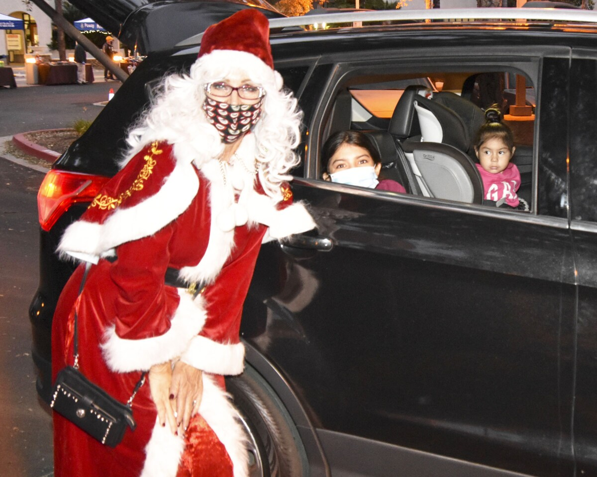 Sharon Gruber as Mrs. Claus with Brissell and Camilla Villanueva.
