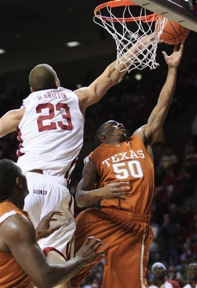Oklahoma forward Blake Griffin, left, reaches to block a shot by Texas guard Varez Ward during the first half of an NCAA college basketball game in Norman, Okla., Monday, Jan. 12, 2009. (AP Photo/Sue Ogrocki)