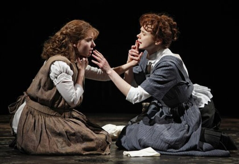 """In this theater publicity image released by Boneau/Bryan-Brown, Abigail Breslin, left, plays Helen Keller and Alison Pill plays Annie Sullivan in the Broadway revival of William Gibson's """"The Miracle Worker,"""" now playing at Circle in the Square Theatre in New York. (AP Photo/Boneau/Bryan-Brown, Joan Marcus)"""