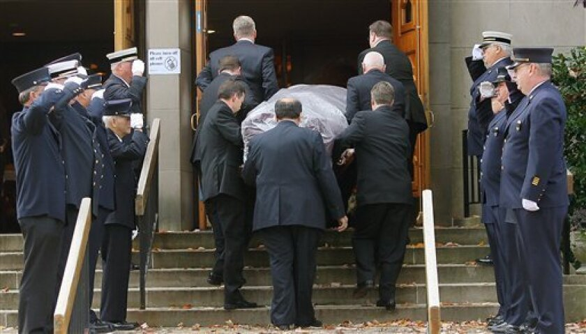 The casket containing the body of Rev. Edward Hinds is carried up the stairs of St. Patrick's Church for the Rite of Reception in Chatham, N.J. on Friday, Oct. 30, 2009. The Roman Catholic priest that was slain a week ago in a brutal attack was remembered Friday as a man with a special gift for comforting the sick and dying. (AP Photo/The Daily Record, Dawn Benko)