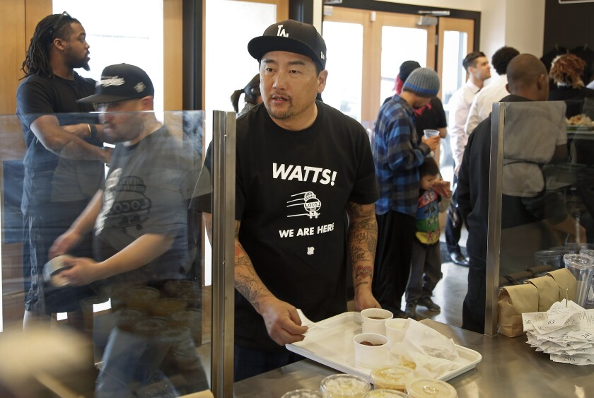 Chef Roy Choi calls out an order number at LocoL, the new fast-food project that he and chef Daniel Patterson have opened in Watts.