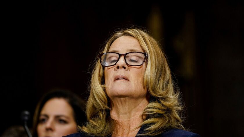 Christine Blasey Ford takes a breath at a Senate Judiciary Committee hearing last month.