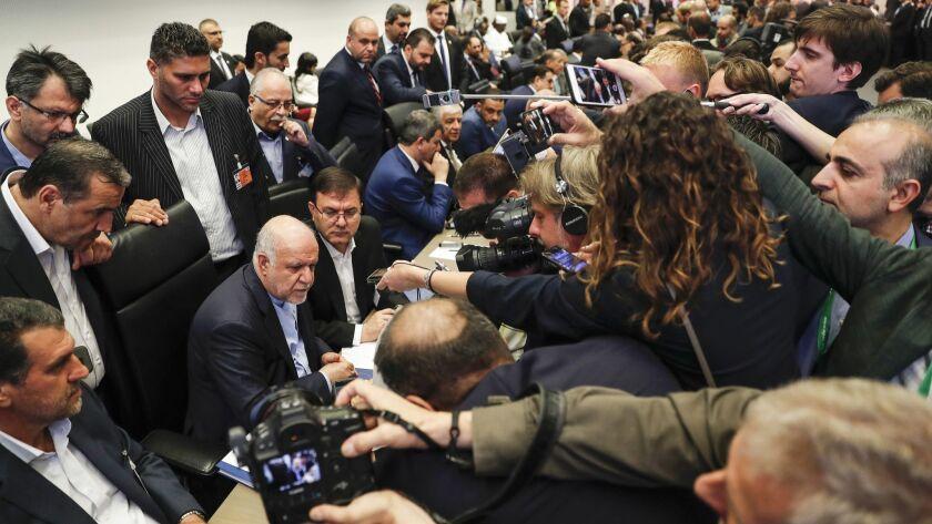Reporters gather around Bijan Namdar Zanganeh, Iran's petroleum minister, at the Organization Of Petroleum Exporting Countries (OPEC) meeting in Vienna.