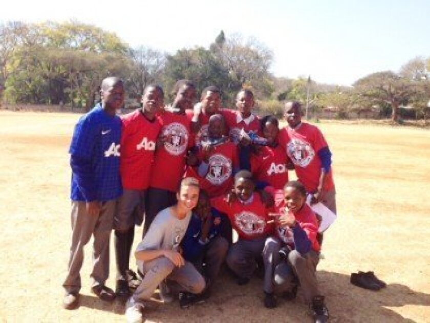 The Harare players in their donated jerseys, with Eli