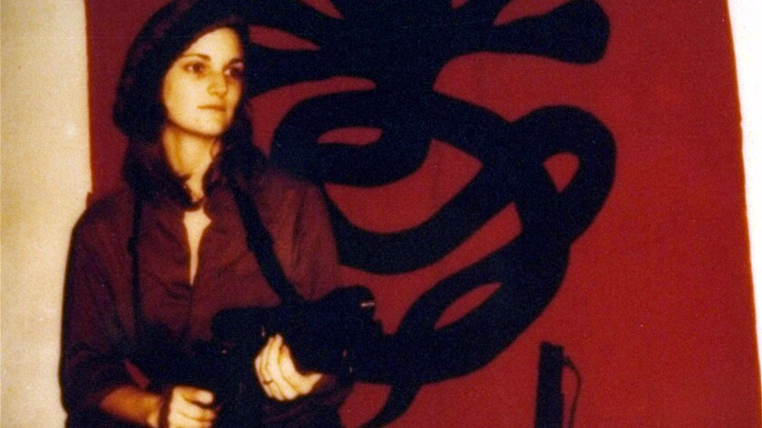 After being kidnapped by the SLA and appearing to join them, Patty Hearst became the epitome of radical chic.