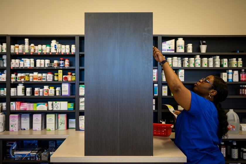 Pharmacy technician Precious Parker fills patient prescriptions.