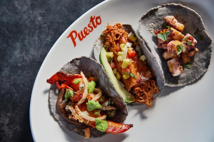 A trio of tacos from Puesto.