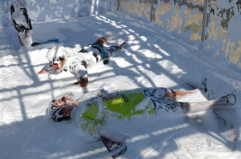 Snow angels in Dr. Bronner's Foam Experience at the Cardiff Surf Classic