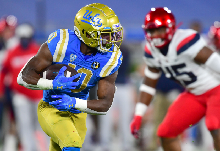 UCLA running back Demetric Felton Jr. carries the ball for a gain against Arizona.