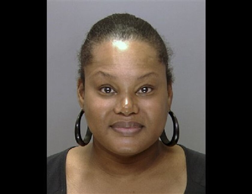 "FILE - This undated file photo provided by the Philadelphia Police Department shows Padge Gordon, also known as Padge Windslowe. Gordon, who calls herself ""the Black Madam,"" performed deadly cosmetic surgery on a London dancer in an airport hotel room, then used glue to close the wounds and fled when the client went into respiratory distress, witnesses testified Wednesday, Oct. 10, 2012. A judge upheld a third-degree murder charge against Gordon after the woman's friend testified about getting silicone injections to enlarge their buttocks in February 2011. (AP Photo/Philadelphia Police Department, File)"