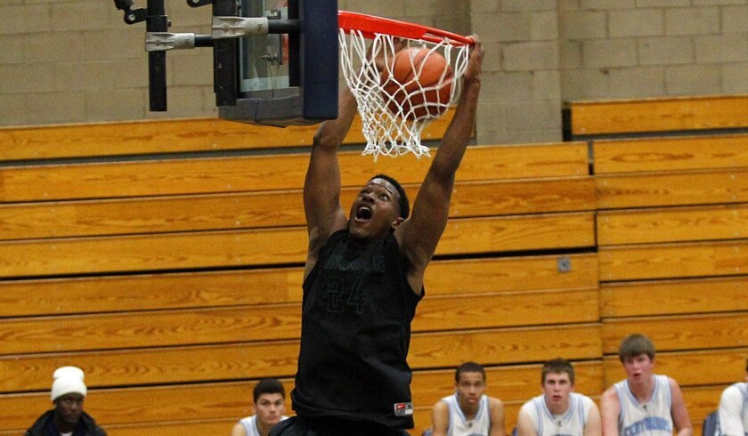 Lincoln's Jeremiah Turner dunks in a win over University City. The Hornets moved to No. 2 in the San Diego Section rankings.