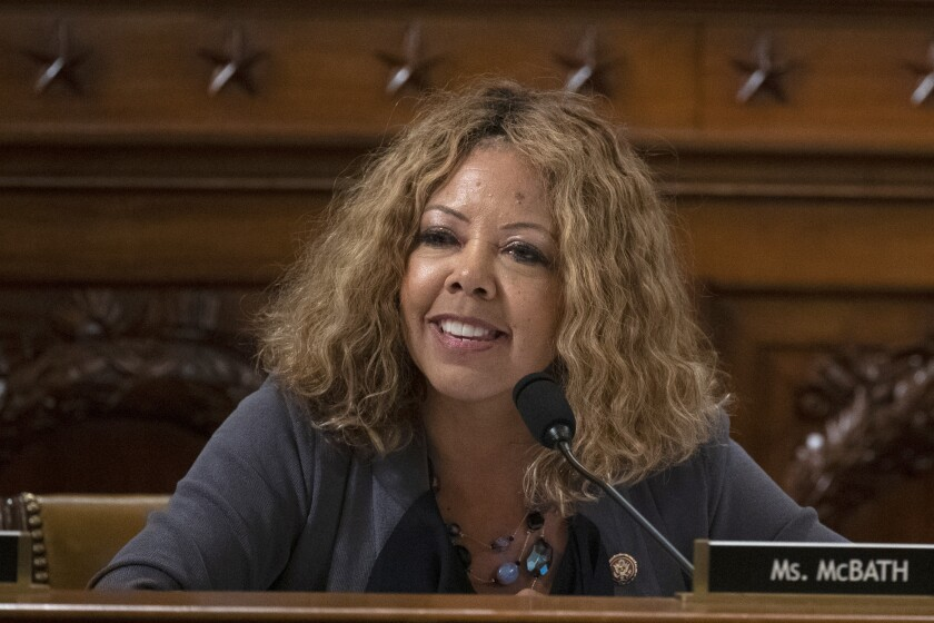 U.S. Rep. Lucy McBath, shown in a Thursday Dec. 12, 2019 file photo on Capitol Hill in Washington, is seeking re-election in suburban Atlanta's 6th Congressional District. She debated Tuesday with her general election opponent, Republican Karen Handel, who McBath narrowly beat in 2018 to claim the seat in an affluent district that includes parts of Cobb, Fulton and DeKalb counties. (Alex Edelman/Pool via AP)