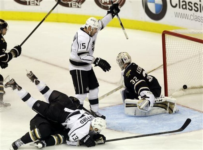 Los Angeles Kings forward Brad Richardson (15) celebrates a goal against Dallas Stars goalie Kari Lehtonen (32), of Finland, during the third period of an NHL hockey game in Dallas on Sunday March 31, 2013. (AP Photo/Mike Fuentes)