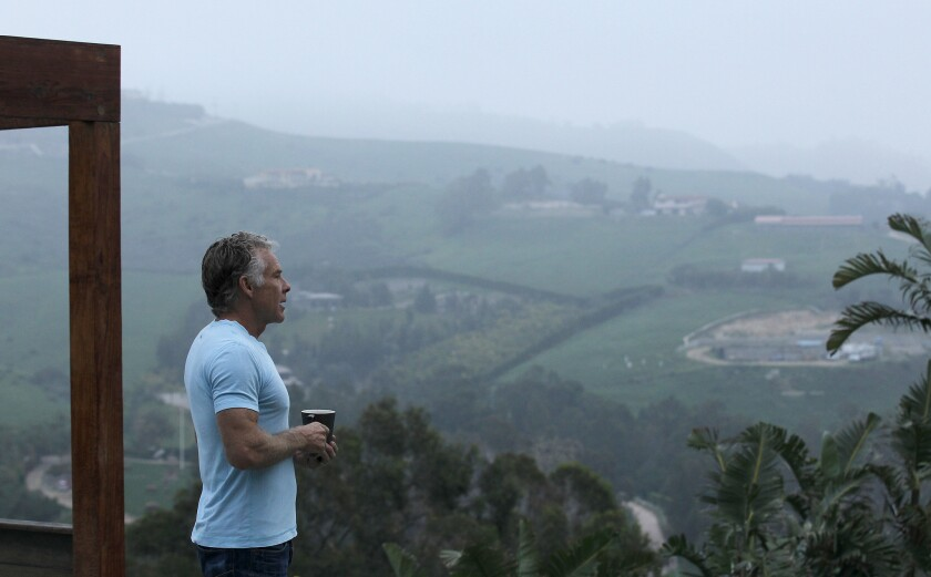 Mark Sisson, creator of the Primal Living Diet, stands for a meditative moment in the yard of his hillside home in Malibu.