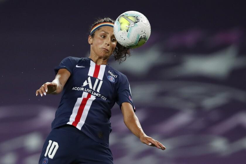 Nadia Nadim heads the ball