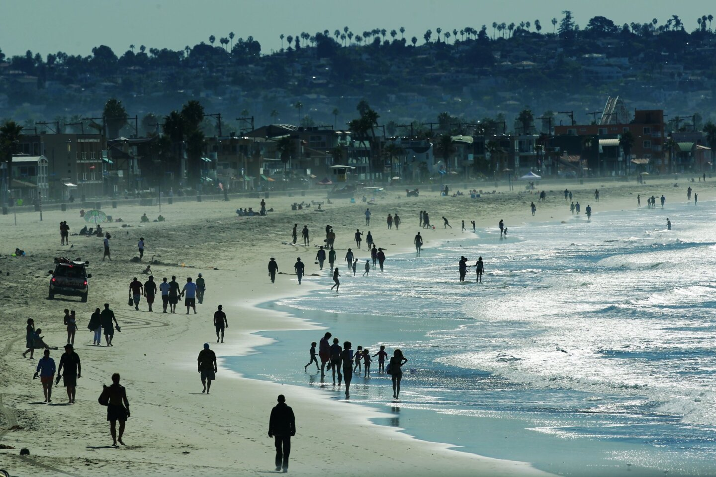 Beach goers enjoy a warm afternoon in Pacific Beach.