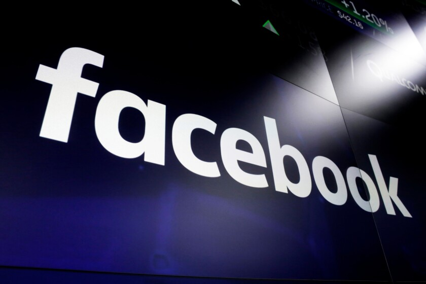 FILE - This March 29, 2018, file photo shows the Facebook logo on screens at the Nasdaq MarketSite in New York's Times Square. Facebook has removed nearly 200 social media accounts linked to white supremacy groups that planned to encourage members to attend protests over police killings of black people — in some cases with weapons, company officials said Friday, June 5, 2020. (AP Photo/Richard Drew, File)