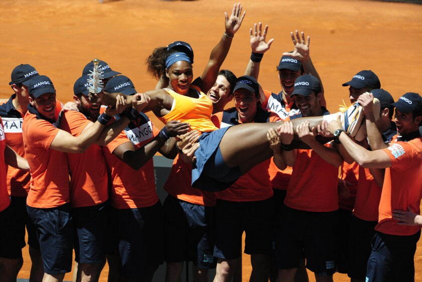 Serena Williams celebrates with Madrid Open volunteers after defeating Maria Sharapova in the final on Sunday.