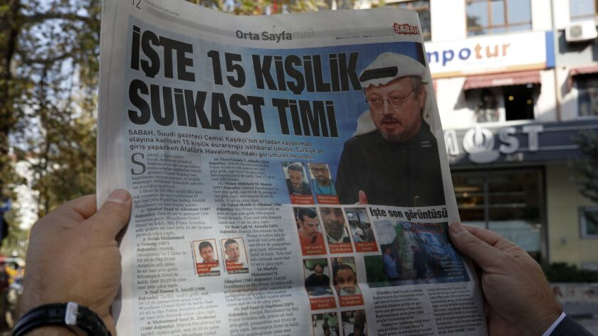 """A man reads the Sabah newspaper, with a headline that reads """"15-member assassination squad """" in Anka"""