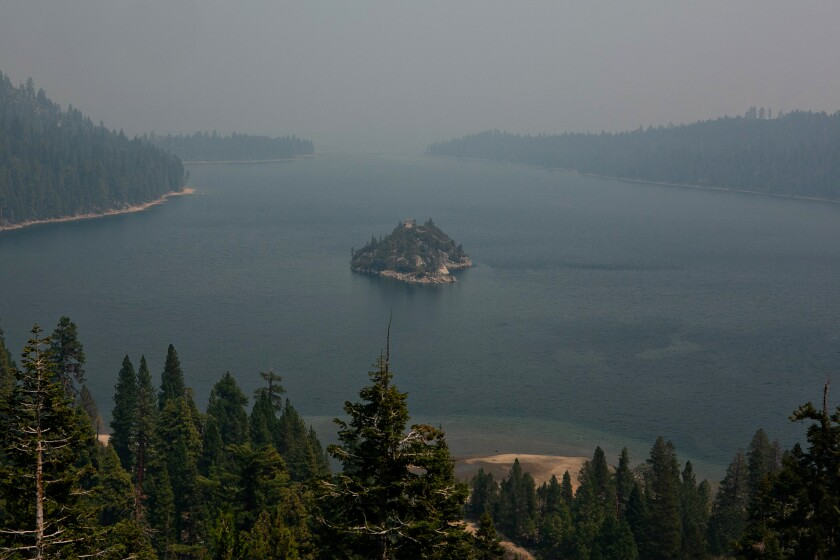 Smoke from the Caldor fire shrouds Fannette Island and obstructs the view of Lake Tahoe.