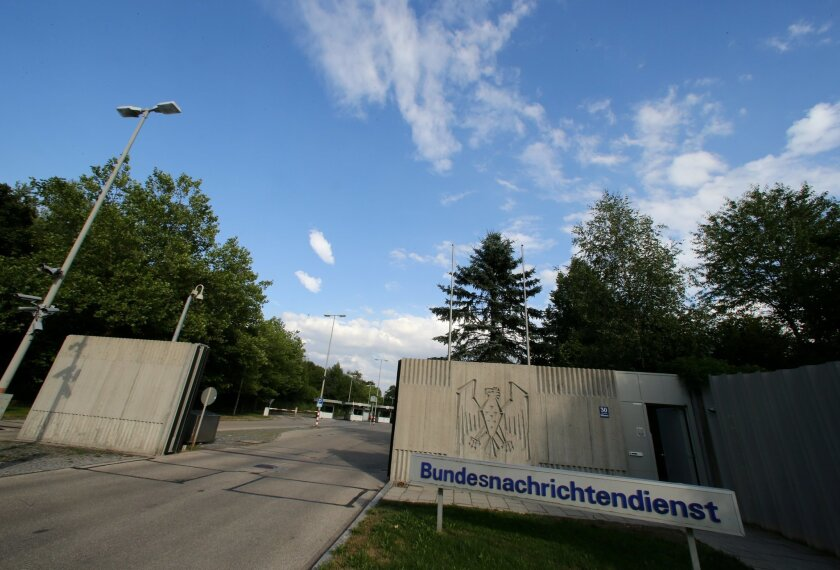 FILE - This Aug. 13, 2013 file picture shows the entrance of the Bundesnachrichtendienst ,BND, in Pullach, Germany. Prosecutors have charged a German spy with treason, breach of official secrecy and taking bribes for allegedly providing secret documents to both the CIA and Russia's intelligence agency. Prosecutors say Thursday Aug. 20, 2015, the 32-year-old man,handled mail and classified documents for Germany's foreign intelligence agency BND. ( Stephan Jansen/dpa via AP)