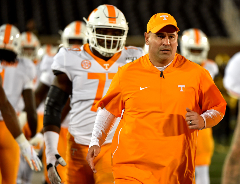 Tennessee coach Jeremy Pruitt of the Tennessee Volunteer runs onto the field with his players