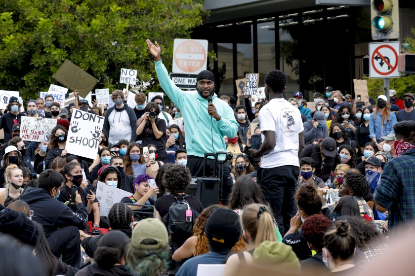 A large group of protestors demonstrated peacefully in front of City Hall in Escondido on Friday.